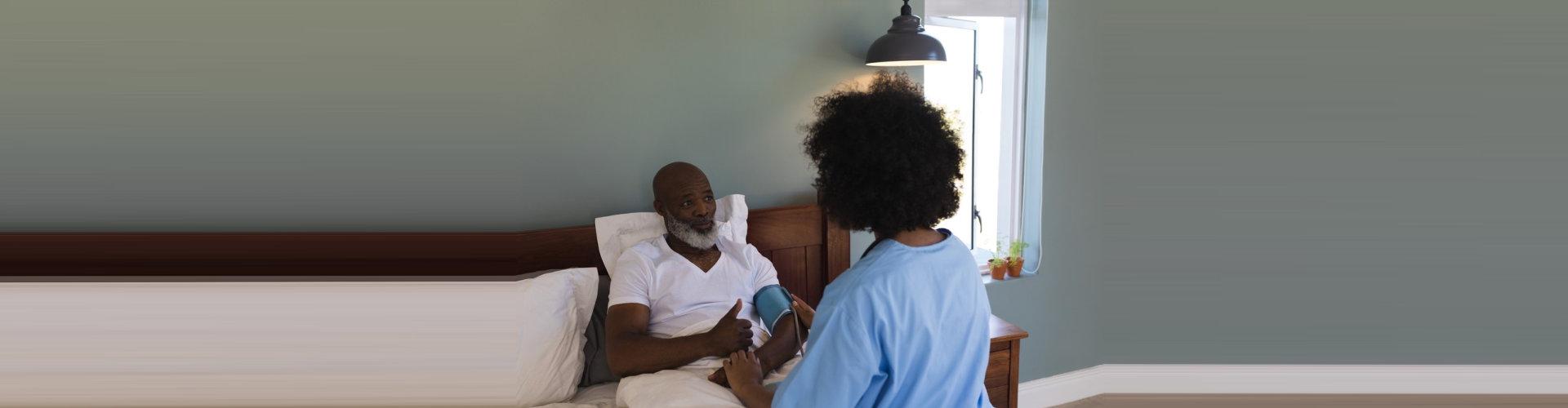 caregiver checking a senior man