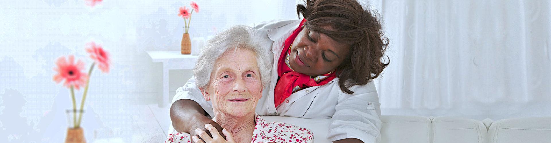caregiver looking at a senior woman