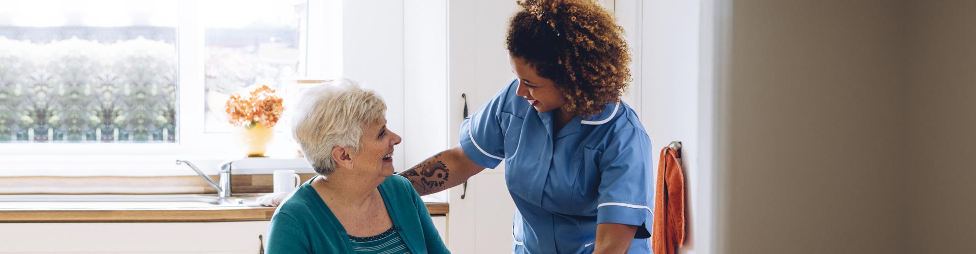 caregiver serving a senior woman